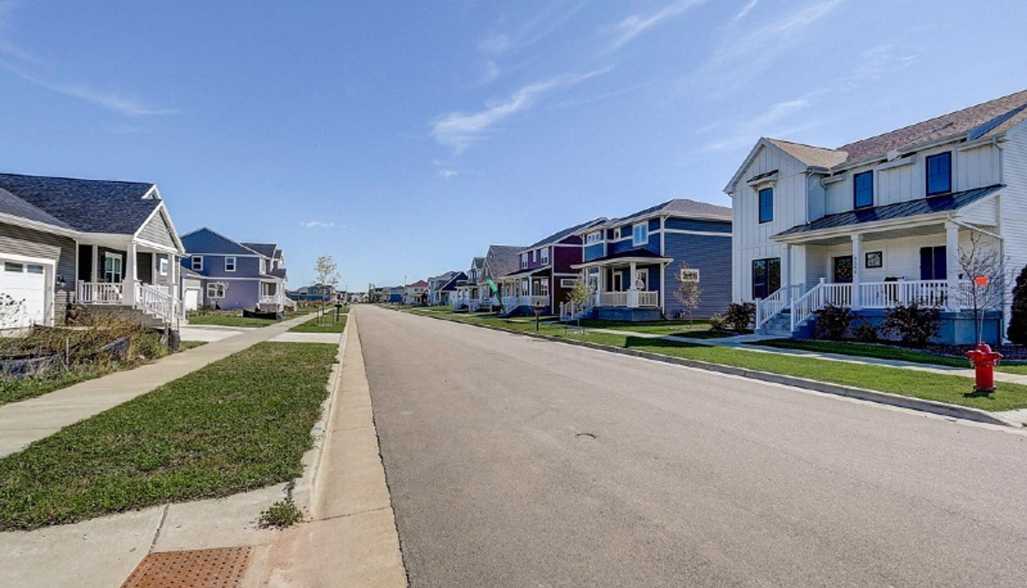 Street of new homes in Sun Prairie WI at Providence