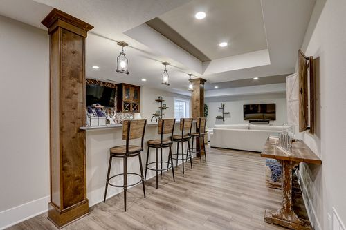 Basement open dining area in a new home by Tim O'Brien