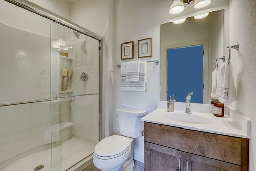 Bathroom with framed shower in a new home in Wisconsin