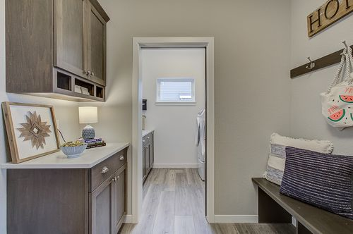 Mudroom with brown cabinets in a new home in Wisconsin