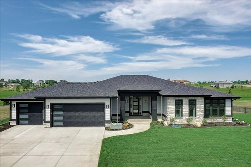 Front Exterior with a three car garage in a new home