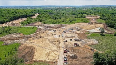 Aerial view of Woodland Preserve homesites under construction