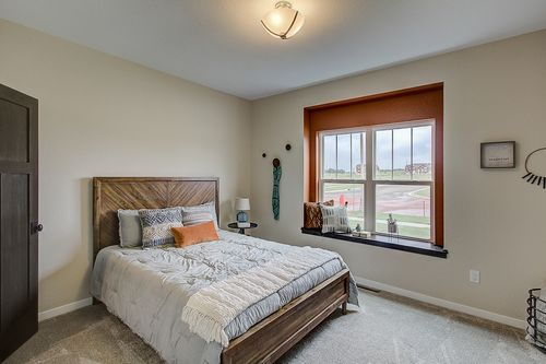 Bedroom with window seat in a new home in Madison WI