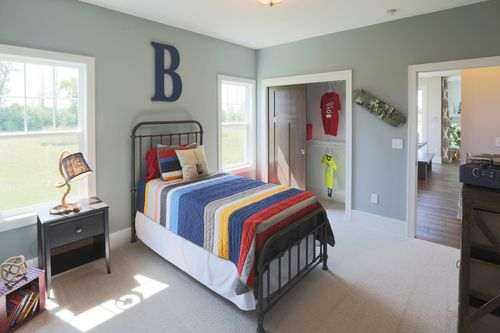 Blue-gray bedroom on main level by Tim O'Brien Homes
