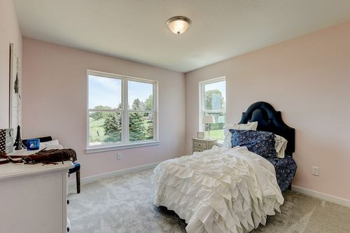 Pink bedroom in a new home in Madison WI