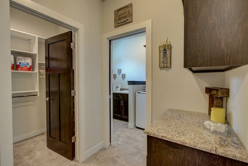 Laundry room with storage in a Madison-area new home