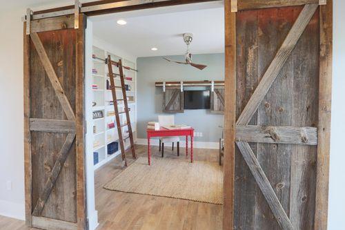 Barn doors outside flex room by home builders in Milwaukee