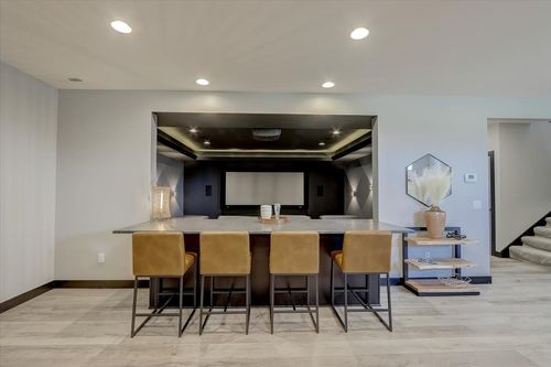 Basement dining room with movie theatre in a new home in Madison WI