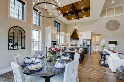 High ceiling kitchen/dining room in a new home by Tim O'Brien