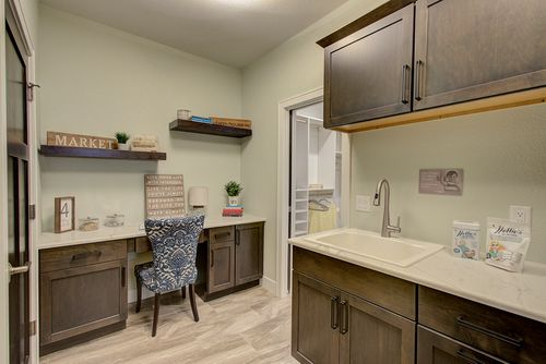 Built-in desk near mudroom in a Madison-area new home