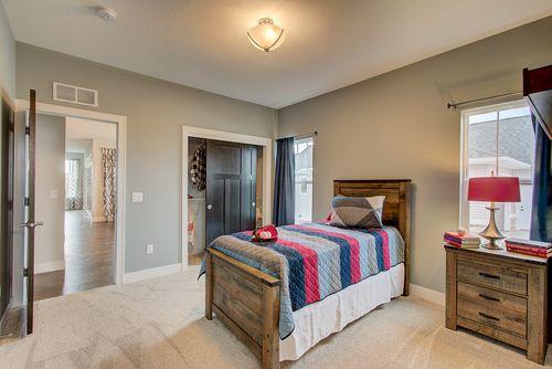 Bedroom with barn doors by Milwaukee home builders