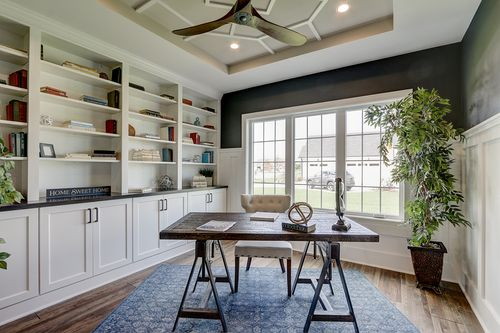 Office with built in shelves in a new home