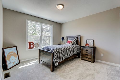 Staged bedroom in a new home in Madison WI