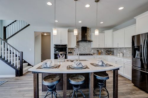 Eat-in kitchen island in a new home in Wisconsin