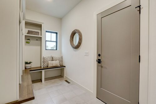 Neutral mudroom in a new home by Tim O'Brien