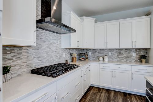 New white kitchen in a model home by Tim O'Brien