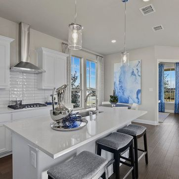 <p>Love the modern touches...3x12 subway back splash, pendant lights and 3 cm quartz counter tops... All included.</p>