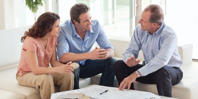 Image of a couple talking with their realtor.